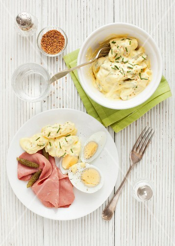 Potato salad with pastrami, hard-boiled eggs and gherkins