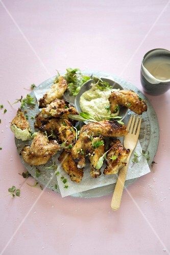 Marinated chicken wings with avocado and herb mayonnaise