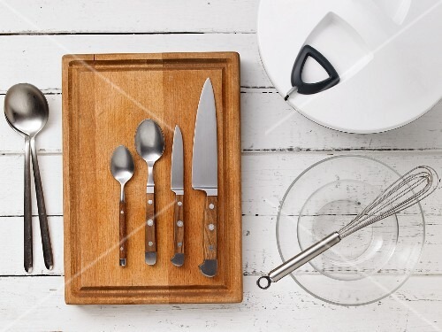 Kitchen utensils for making soused herring salad with melon