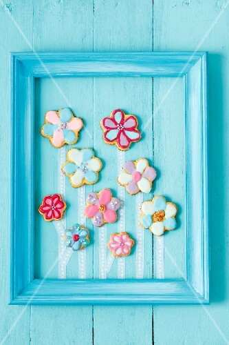 Flower shaped biscuits with colourful icing