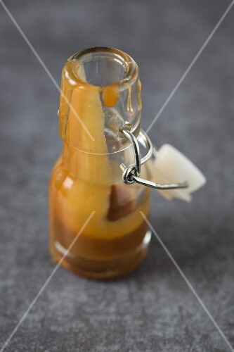 Caramel sauce in a small flip-top bottle