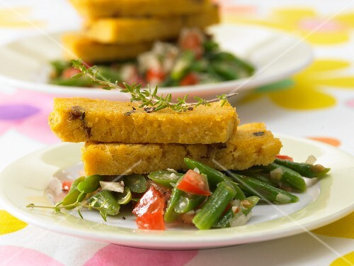Polenta slices with a bean and tomato medley