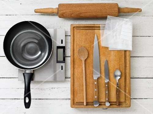 Kitchen utensils for making orange cream with roasted nuts