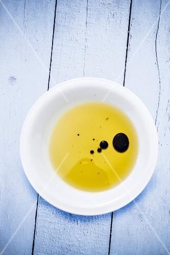 Drops of balsamic vinegar in olive oil