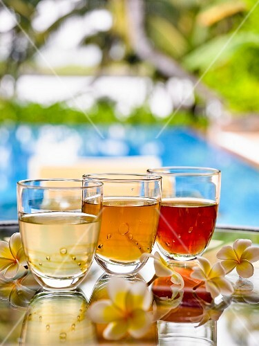 Various glasses of herb tea