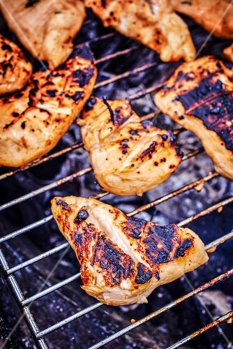 Chicken bits on a barbecue