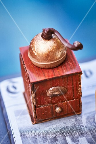 An old-fashioned coffee grinder made from chocolate