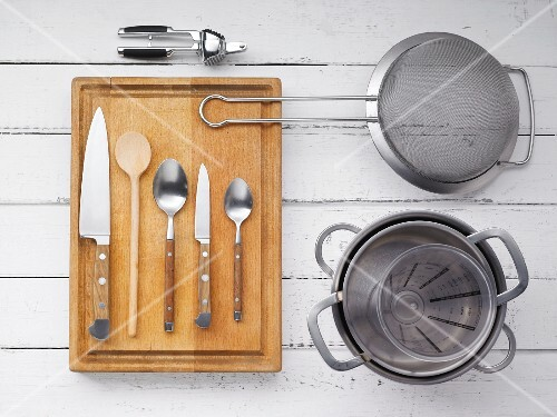 Kitchen utensils for making a creamy sauce with leek and salmon caviar