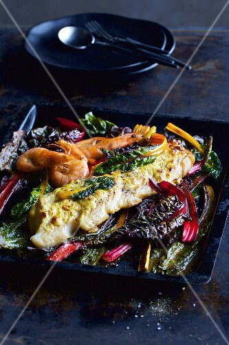 Oven-baked fish gratin with chard and prawns