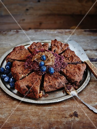 Gluten-free chocolate mudcake with nuts and blueberries