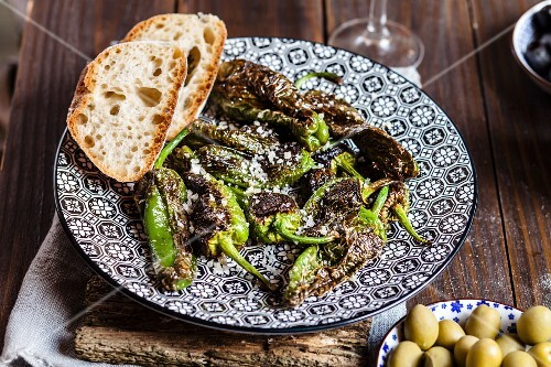 Tapas: Pimientos De Padron (roasted peppers) with sea salt and bread (Spain)