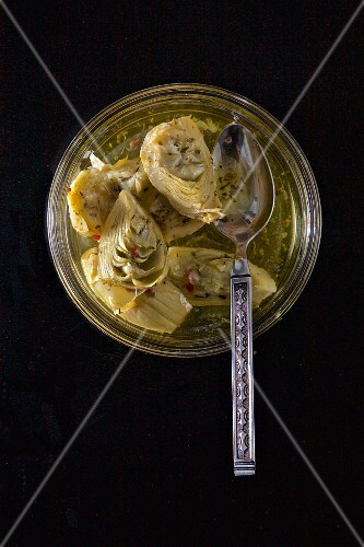 Steamed Artichokes on Plate with Herbed Olive Oil