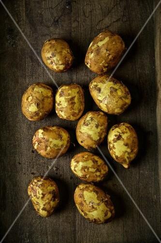 Yukon Gold potatoes on a wooden surface