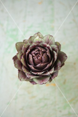 Artichokes on a rustic surface