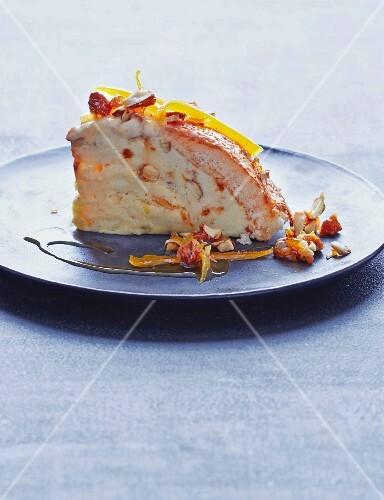 A slice of Cassata with sponge cake, and almond and orange ice cream
