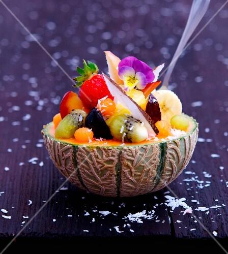 Fruit salad served in a melon half