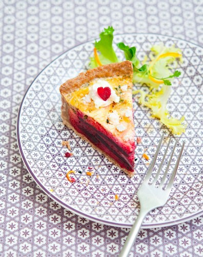 A slice of beetroot and orange quiche
