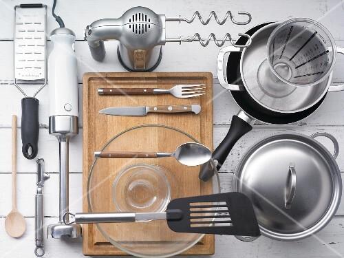 Kitchen utensils for preparing burgers and potatoes