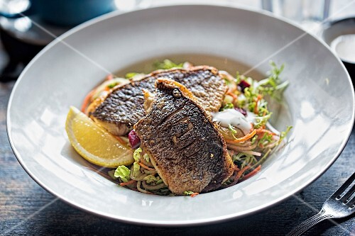Vegetable salad with beetroot and grilled sea bass