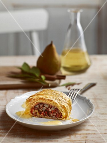 Bavarian blood sausage strudel with pear sauce