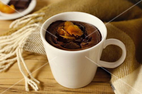Warm chocolate dessert with dried fruit in a cup
