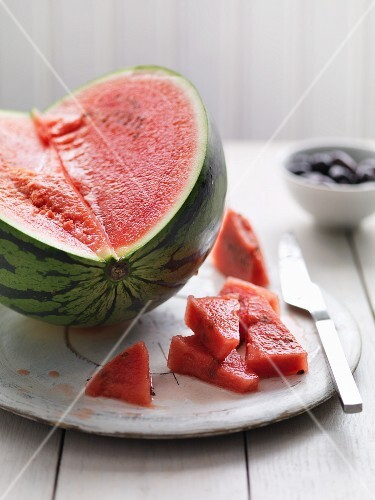 A slice of watermelon and olives