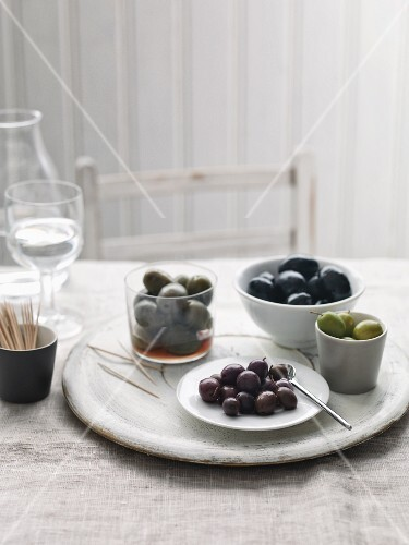 Assorted olives with toothpicks
