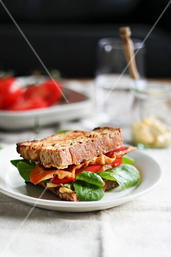A BLT Sandwich with bacon, tomato and spinach