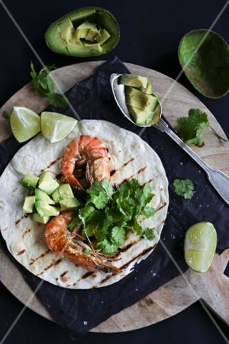 Shrimp tacos with lime, avocado and coriander