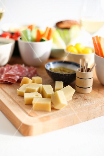 A snack platter with cheese, salami and vegetables