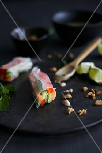 Asian vegetarian rice paper rolls with peanut sauce