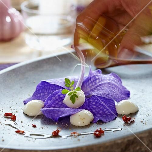 Drizzling olive oil onto Vananco leaves