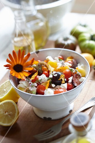 Tomato salad with cheese and edible flowers