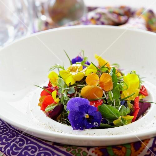 A colourful edible flower & herb salad