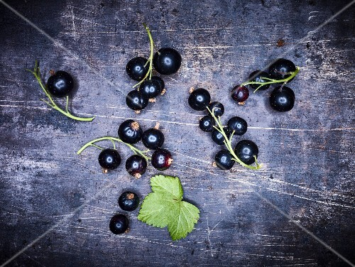 Blackcurrants on a dark surface