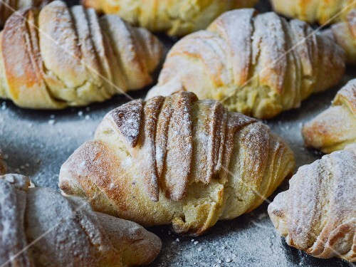 Home-made croissants dusted with icing sugar