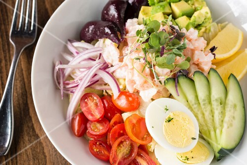 A vegetable salad with shrimps and hard-boiled eggs
