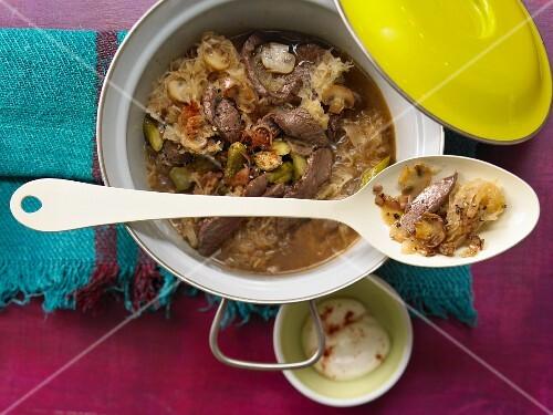 Sauerkraut stew with beef, mushrooms and gherkins