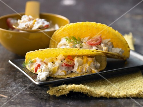 Tacos filled with sheep's cheese, sweetcorn and cocktail tomatoes