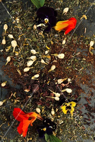 Assorted herbal and fruit teas with edible flowers (full-frame)