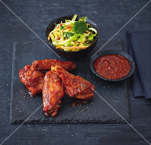 Marinated chicken wings with a pointed cabbage and carrot salad