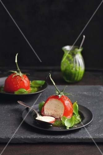 Tomato mousse coated in jelly with basil pesto