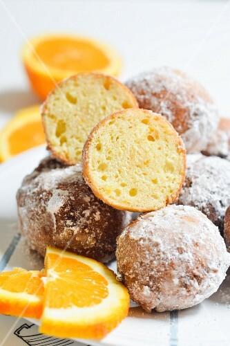 Freied ricotta & orange doughballs rolled in icing sugar