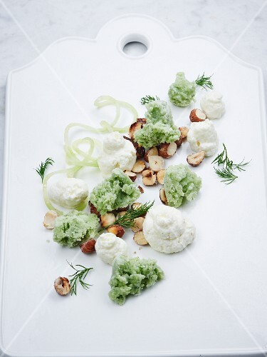 Yoghurt mousse with cucumber sorbet and roasted hazelnuts
