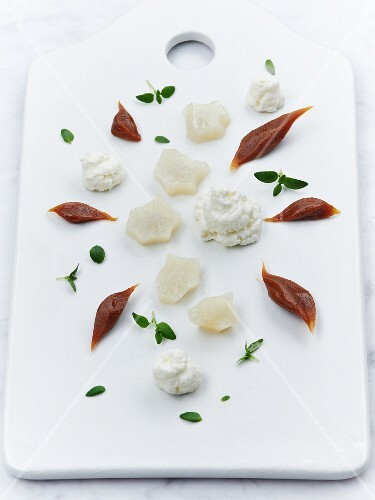 Dessert made from steamed Jerusalem artichokes with yoghurt mousse and caramel