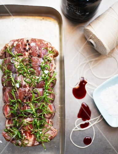 Saddle of lamb with rosemary and port wine being made