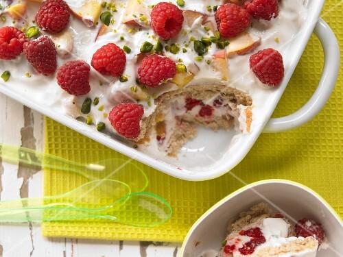 A layered fruit yoghurt dessert with raspberries and nectarines