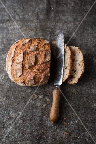 A sliced loaf of country bread