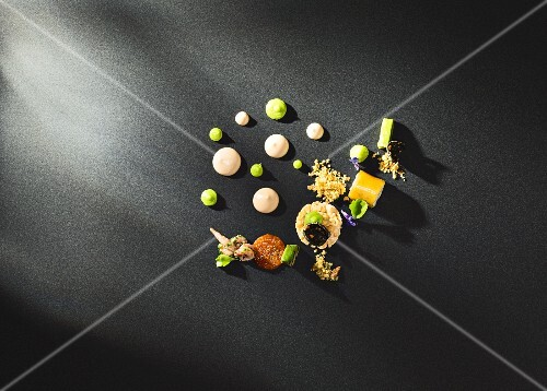 Variations on prawn cocktail on a black surface