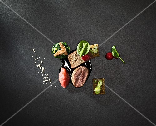 Variations of venison on a black surface